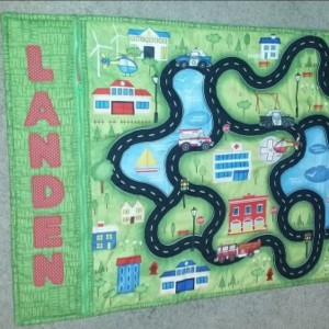 Roll up take along car play mat