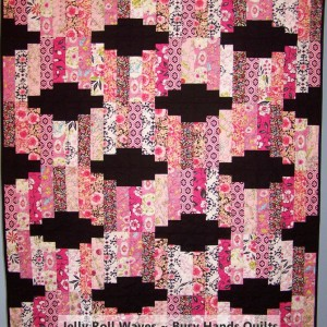 Jelly Roll Waves Lap Quilt in Pink and Black