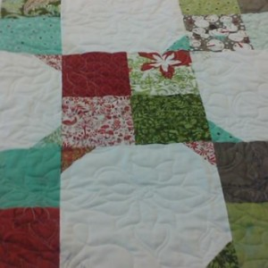 Scrappy 4 Patch Christmas quilt