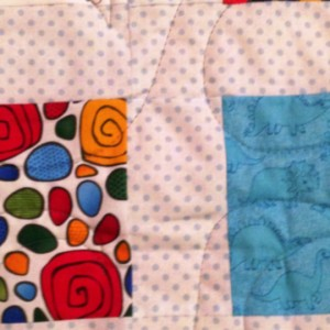 Ren's baby quilt - sashed charms