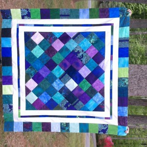 Jewel toned charm quilt on point