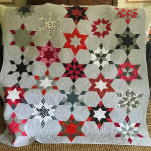 Pink and gray star quilt