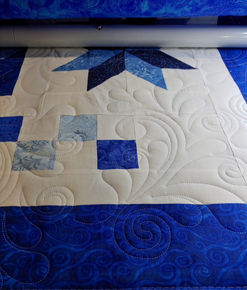 Blue quilt for neighbor's son