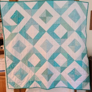 Baby quilt with a boo-boo