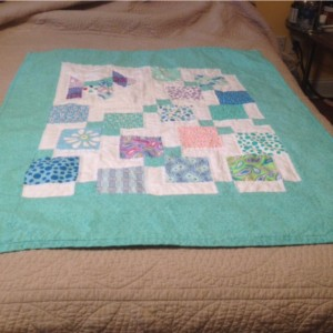 Baby quilt with puppy.
