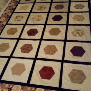 My first applique quilt with hexagons