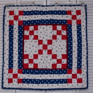 Red, white and blue wall hanging