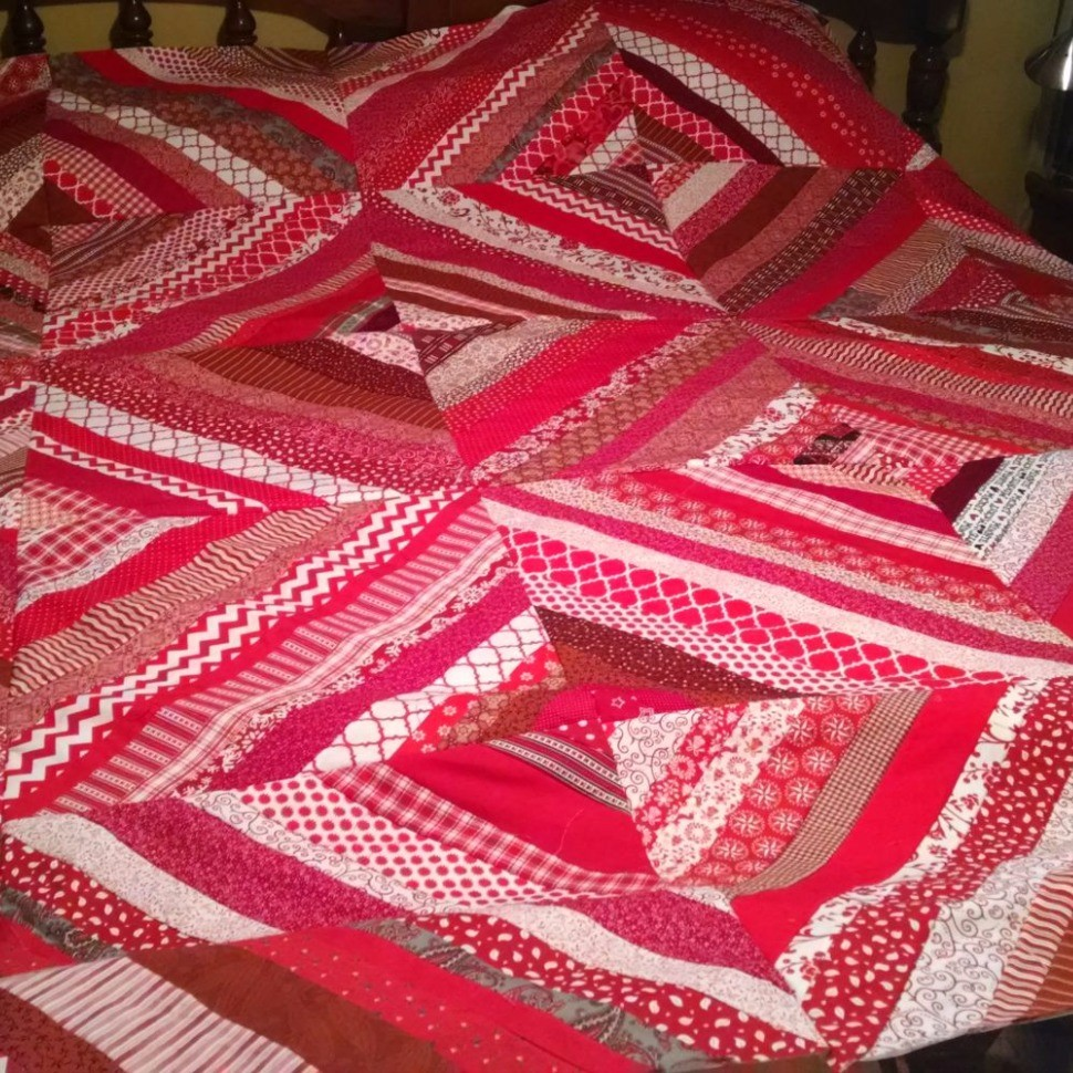 Red and White Strip Quilt